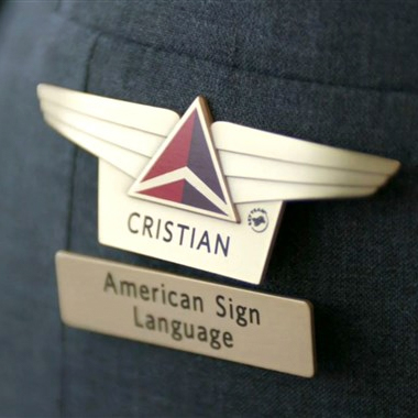 Accessibility Matters: Delta sign language pin for ASL