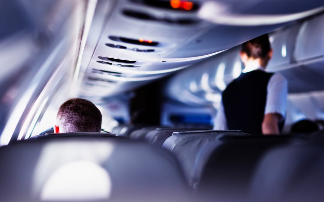 A flight attendant services an airline cabin