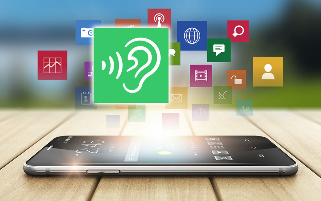 Smartphone with images of hearing app icons floating above phone