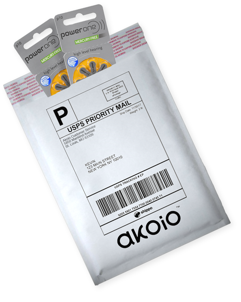Akoio white padded envelope with two packs of hearing aids rotated